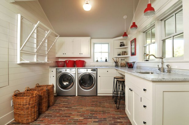 Country Laundry Room with a Red and White Laundry Room and Brick Flooring