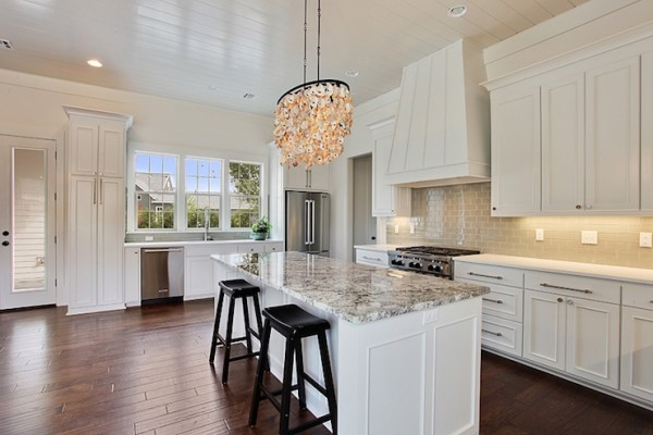 white kitchen with grey granite White Kitchen Cabinets with Gray Subway Tile Backsplash - Transitional - Kitchen