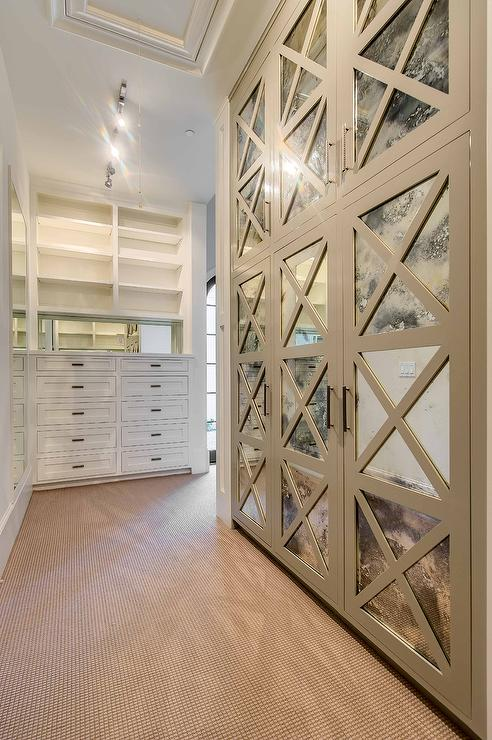 Closets with Antiqued Mirrored Doors  Transitional  Closet