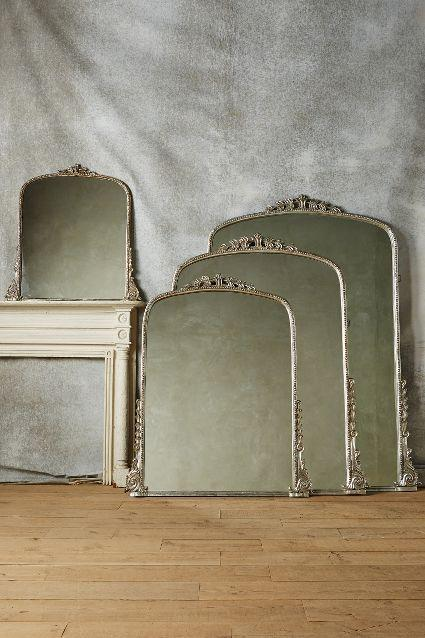 living room wall paint finish lighting high ceiling arched silver gleaming primrose mirror