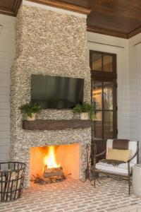 Covered Patio Fireplace with Flatscreen TV - Transitional ...