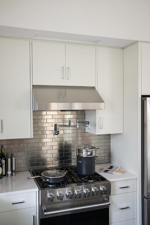 Hidden Flatscreen TV Over Kitchen Hood  Transitional