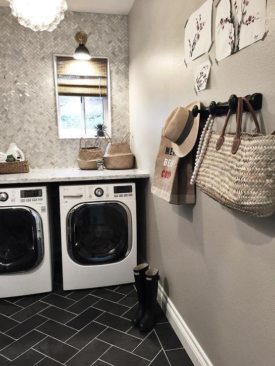 Laundry Room with Marble Herringbone Backsplash Tiles