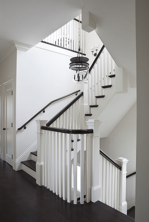 White Staircase with Brown Hand Rail