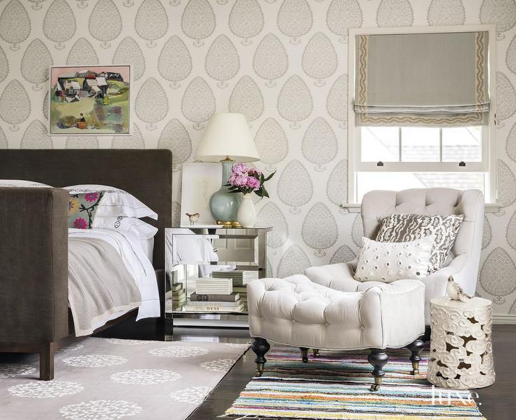 tufted chair and ottoman linenfold cover master bedroom transitional