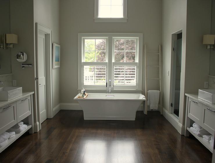 Tub under Windows Dressed in Plantation Shutters  Transitional  Bathroom