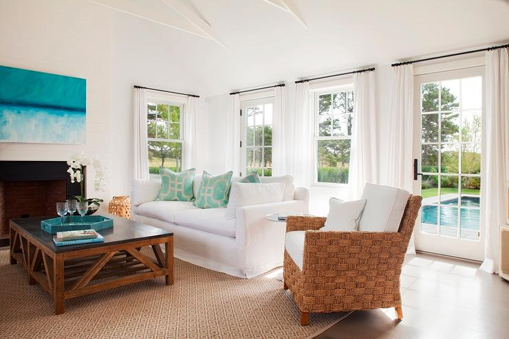 white slipcovered sofa living room small space ideas with aqua pillows cottage