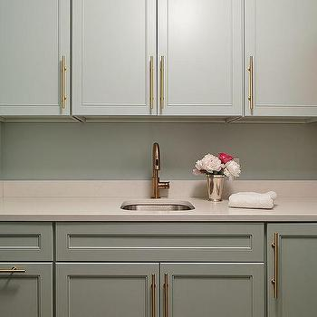 brass kitchen pulls lights over sink long cabinet design ideas gray laundry room cabinets with