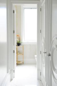 Closet Doors with Circular Panels - Transitional - Bathroom
