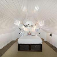 Attic Bedroom with Built In Bed Under Sloped Ceiling ...