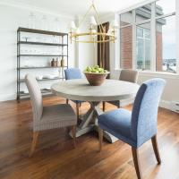 Round Gray Trestle Dining Table with Mismatched Dining ...