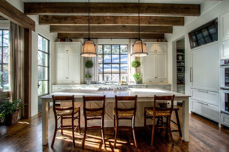 country kitchen islands sink plumbing kit ceiling beams design ideas features wood over an expansive center island with legs fitted a cooktop lined rush seat counter stools illuminated