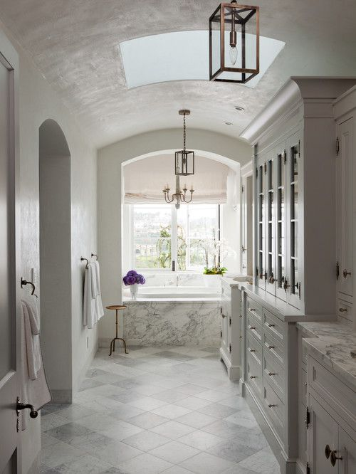 Long Bathroom with Barrel Ceiling and Skylight