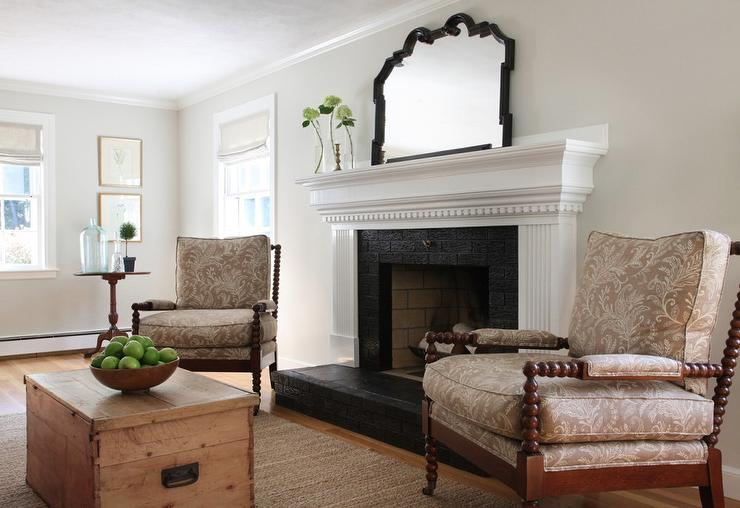White Fireplace Mantle with Black Brick Surround and