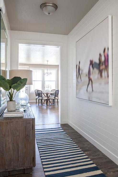 Long Cottage Foyer with Shiplap Walls  Transitional