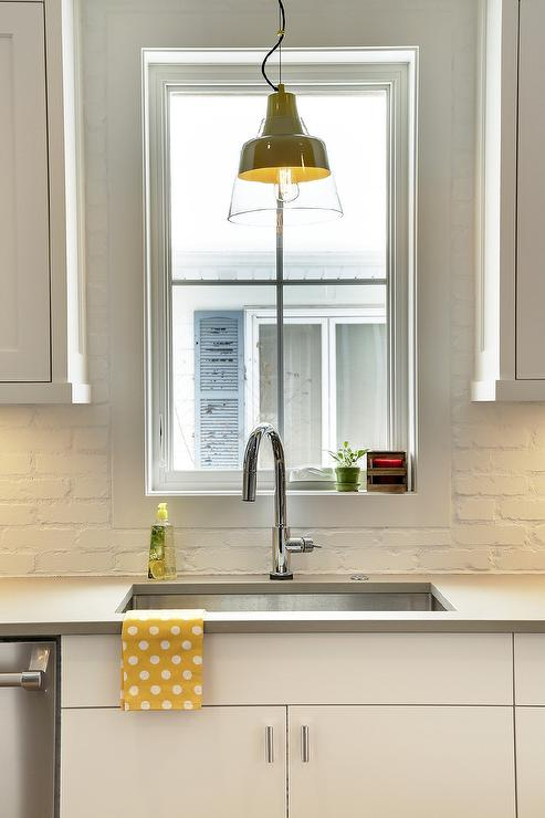 stainless steel kitchen pendant light high end kitchens white painted brick backsplash - transitional ...