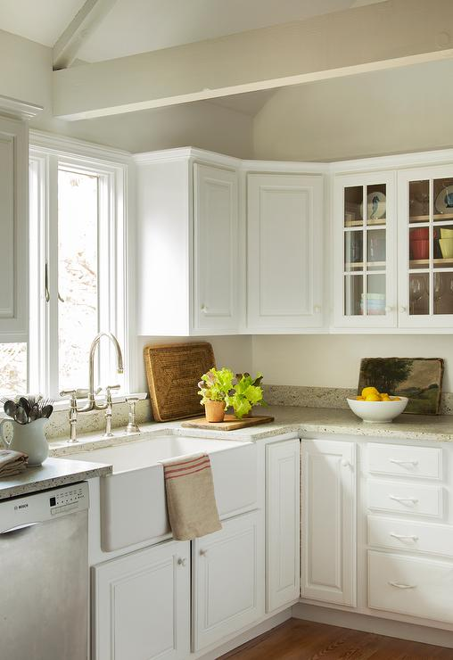 raised panel kitchen cabinets low profile faucet light grey design ideas cottage features white paired with granite countertops fitted a farmhouse sink and deck mount gooseneck