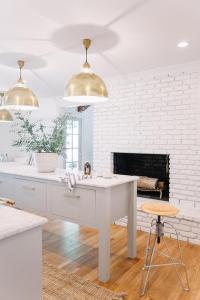 Kitchen with White Brick Fireplace - Transitional - Kitchen