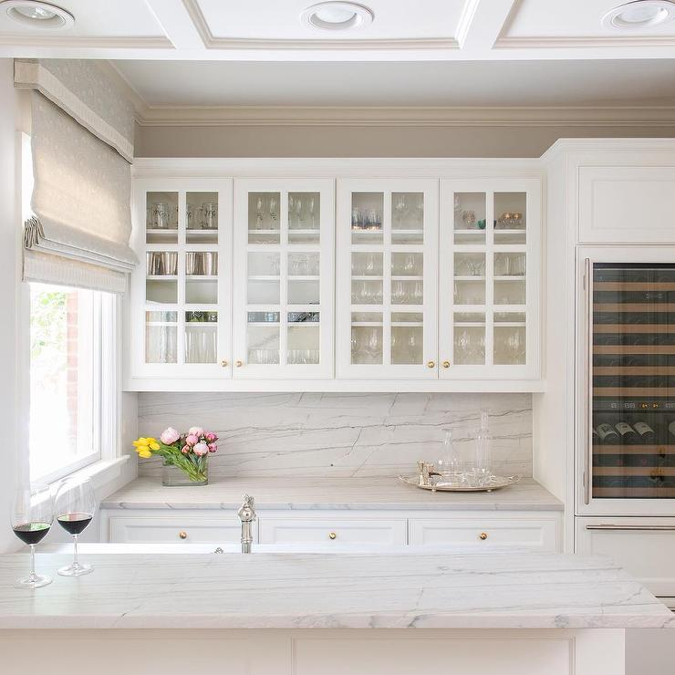 Glass Front Kitchen Cabinets with Gold Knobs