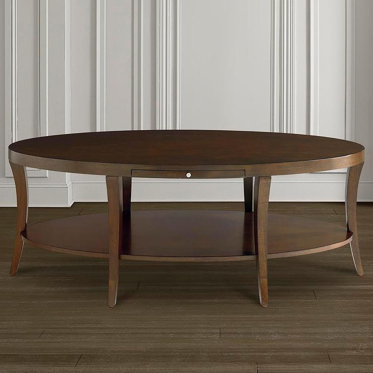 oval coffee table with pullout shelf in