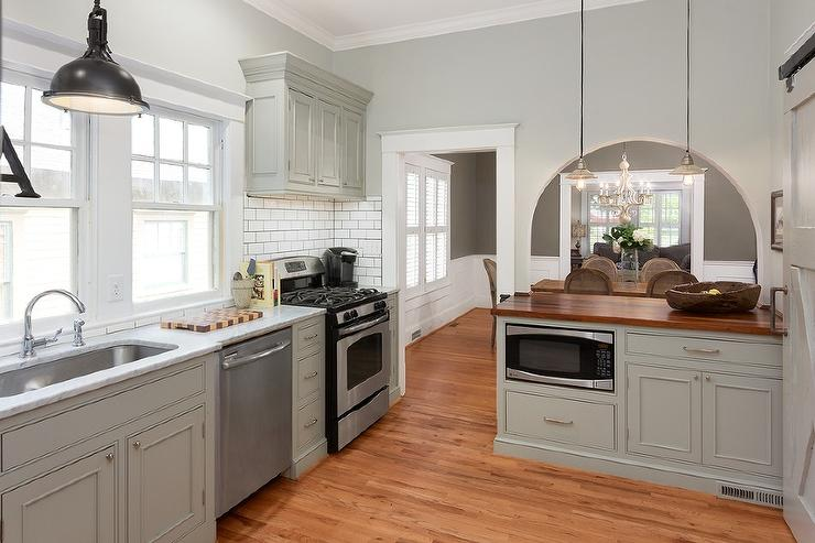 Gray Kitchen Peninsula with Butcher Block Countertop