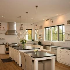 Kitchen Island And Table Double Doors With Drop Down Design Ideas Two Glass Cone Shaped Pendants Hang Over A White Topped Soapstone Fitted Prep Sink Next To Top Dining