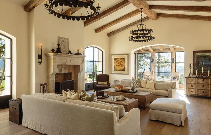 mediterranean living room chair arrangements with cathedral ceilings