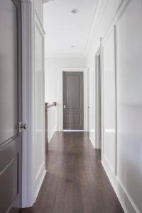 White Walls with Gray Doors - Contemporary - Entrance/foyer