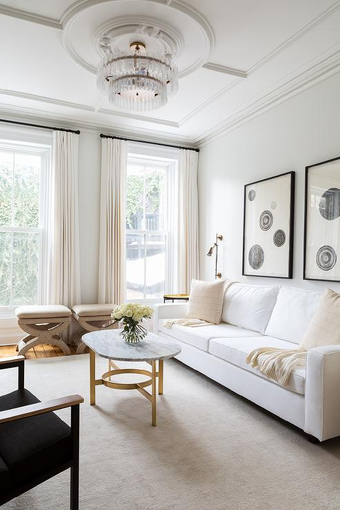 White Sofa with Oval Marble and Brass Coffee Table