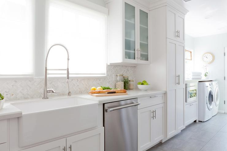 Long Kitchen Features White Shaker Cabinets Paired With Off White Quartz  Countertops And An Ann SacksKitchen Laundry Combo Designs   Ideasidea. Kitchen Laundry Combo Designs. Home Design Ideas