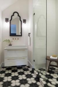 Small Bathroom with Black and White Geometric Tile Floors ...