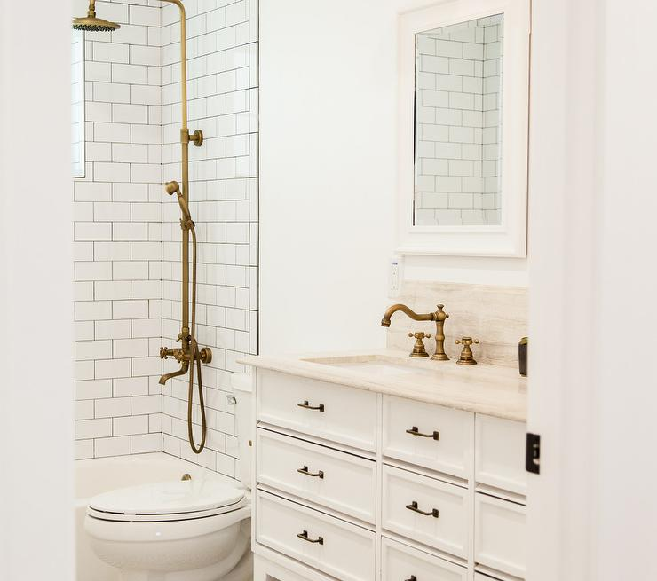 Shower Subway Tiles with Dark Grout and Brass Exposed