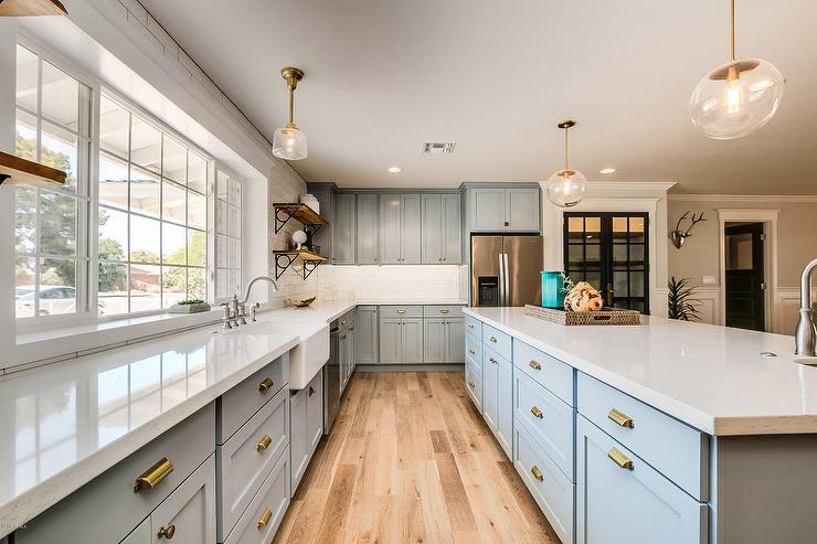 Blue Shaker Cabinets with Gold Hardware  Transitional