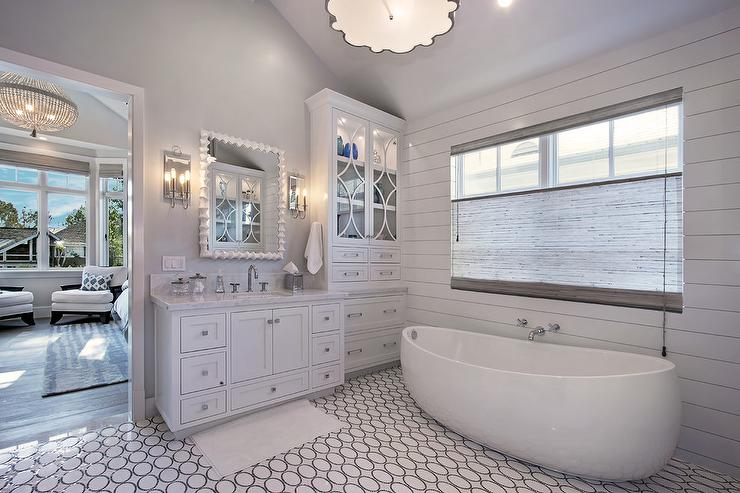 White And Gray Bathroom Features A Shiplap Clad Accent Wall Lined With A Tub Filler Over An Egg