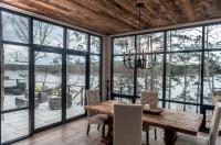 Contemporary Cabin Dining Room with Floor to Ceiling ...