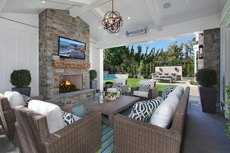 Wicker Outdoor Sofas and Chairs with Navy Trellis pillows