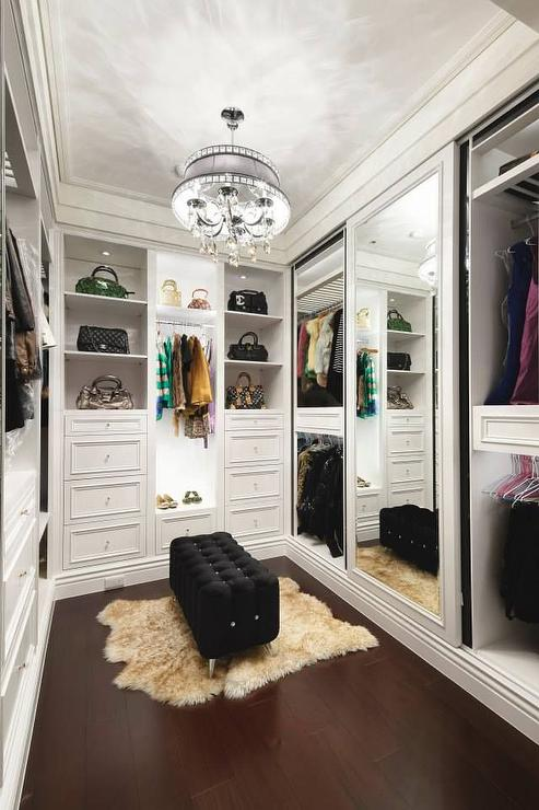 Walk In Closet With Black Tufted Bench On Lucite Legs