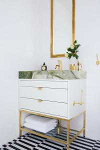 White and Gold Bathroom with Black and White Striped ...