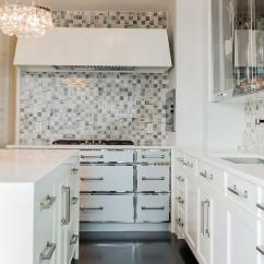 Kitchen Trim Moen Renzo Faucet Stainless Steel On Cabinets Design Ideas Contemporary Features A Pair Of Ochre Arctic Pear Chandelier Hangs Over An Island Accented With White Waterfall Countertop