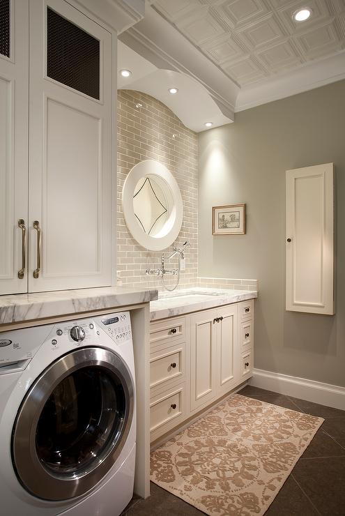 White Laundry Room with Gray Brick Tiles  Transitional