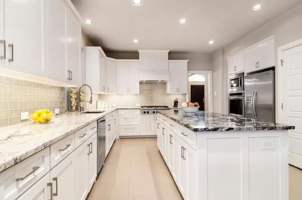 white kitchen with grey granite White Kitchen with Gray Glass Backsplash and Granite