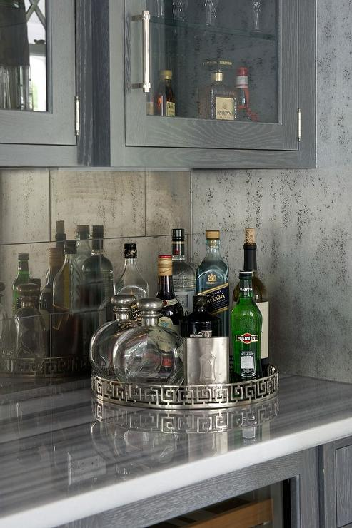 Gray Bar Cabinets with Antiqued Mirrored Backsplash Tiles