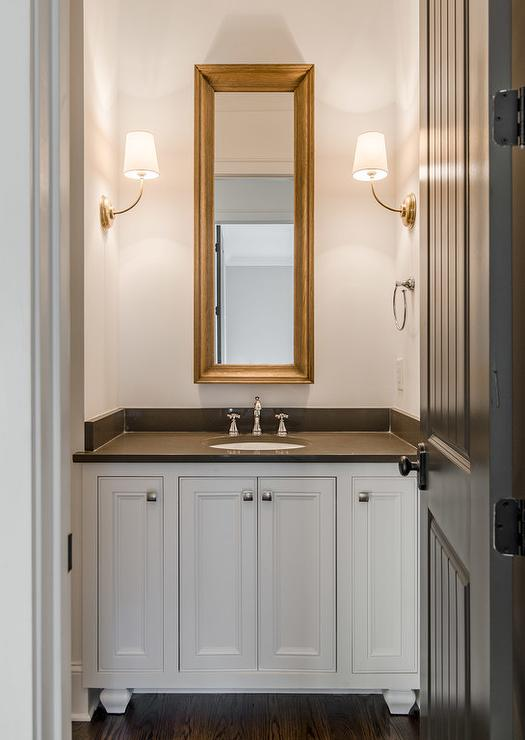 White and Gray Powder Room with Brass Vendome Single