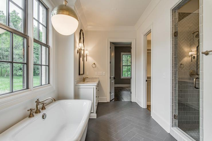 White Bathroom with Dark Gray Herringbone Tile Floor  Transitional  Bathroom