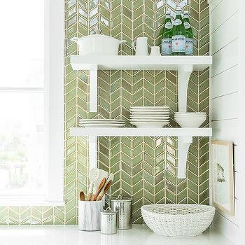 green herringbone tile backsplash