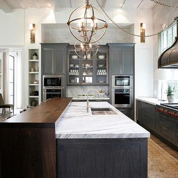 bronze kitchen faucet pull down black sinks charcoal gray cabinets with brass sphere pendants ...