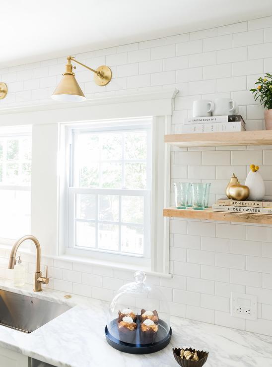 white kitchen with delta trinsic deck