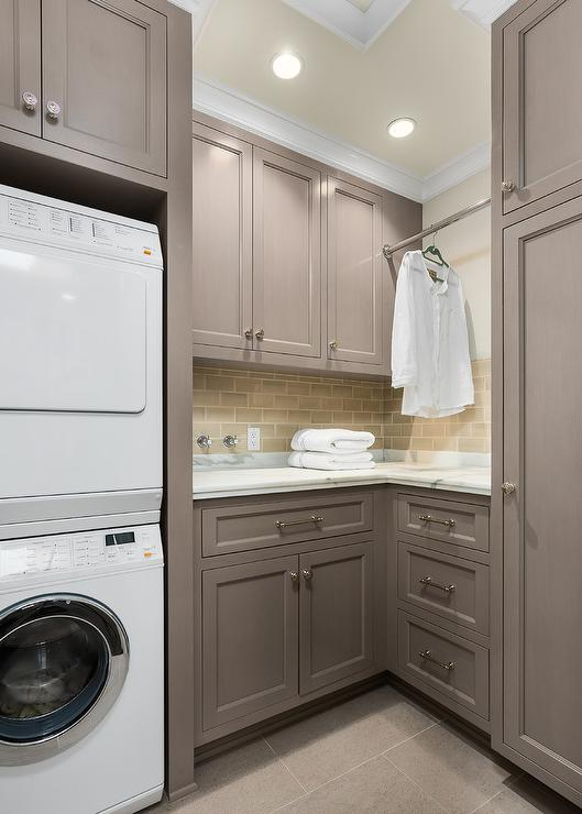 Gray Laundry Room Cabinets with Tension Pole Clothes