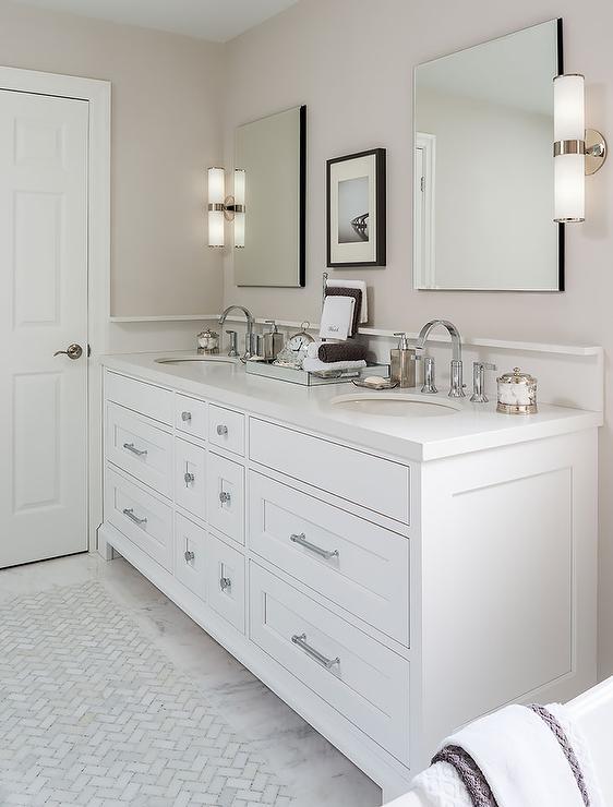 white marble bathroom floor with inlays of white marble herringbone