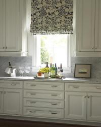 ivory Kitchen Cabinets with Carrera Marble Countertop and